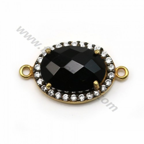 Faceted oval black spinel set in gold-plated silver with zirconium 13*17mm x 1pc