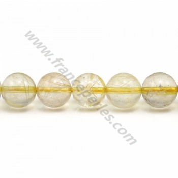 Rutile quartz, of round shape and in size of 10 - 11mm x 40cm