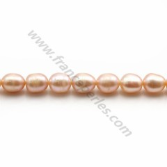 Freshwater pearls colored salmon, in oval shaped, 6 - 6.5mm x 10pcs